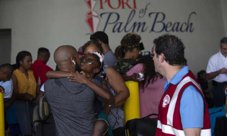 Mark Winder greets his niece Gabriella at Port of Palm Beach after arriving on the cruise ship Grand Celebration in West Palm Beach, Florida, at the weekend.