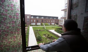 Baylis Old School resident Salvatora Rea looks out at the communal play area and garden his children were barred from using. The developer has since backed down.