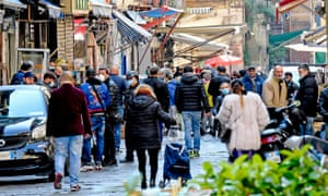 People sell and shop for food in the street market of the 'Porta Nolana' in Naples, Italy, 04 April 2020.