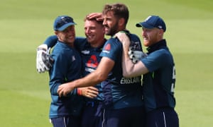 Joe Root, Jos Buttler Liam Plunkett and Ben Stokes of England celebrate the wicket of K. L. Rahul of India.