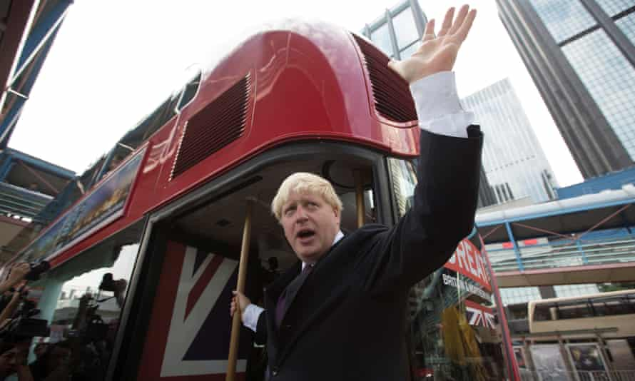 Boris Johnson waves from a new London Routemaster bus during a visit in Hong Kong in 2013.
