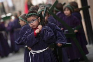 Children carry crosses during a parade in the northern Basque village of Segura in Gipuzkoa