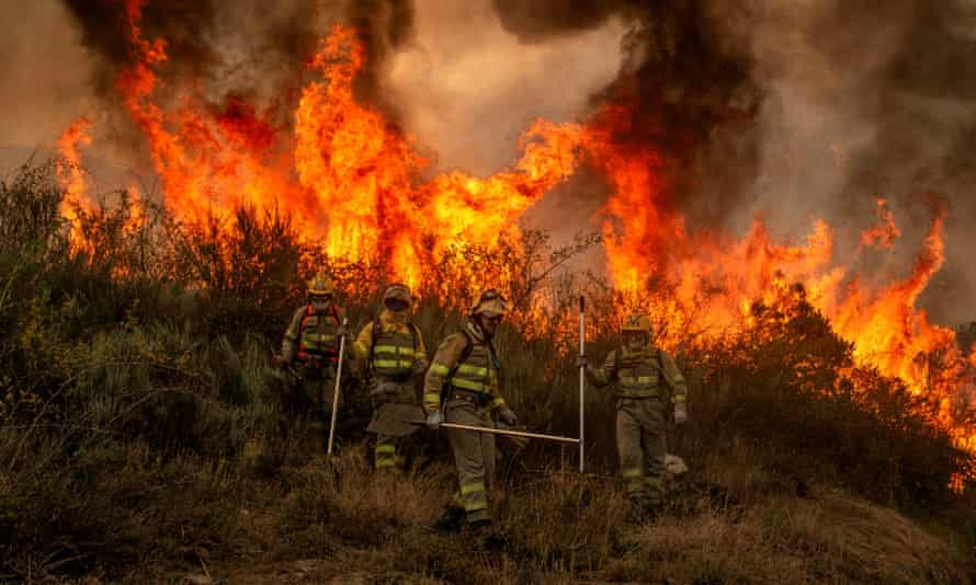 Firefighters battle a forest fire in Rubia, Ourense, Galicia, northern Spain, on 12 August 2021.