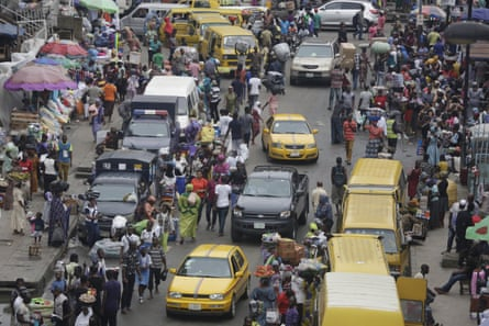 Pedestrians shop at a market in Lagos, Nigeria.