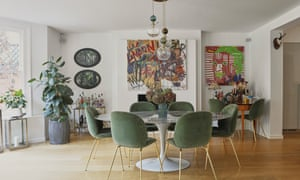 Green velvet chairs in the dining room.