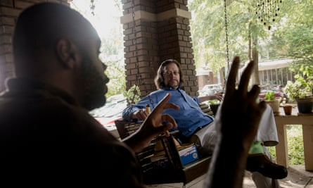 Activist James Cathey (left) chats with ACLU attorney Scott Kramer (right) after the last day of trial in a suit alleging that the Memphis Police Department was routinely surveilling activists in defiance of a binding consent decree.