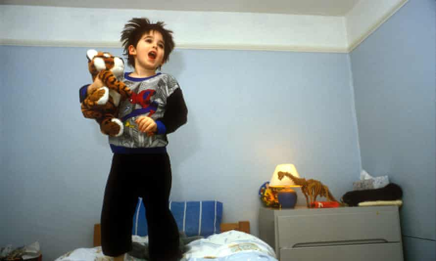 Young child jumping on the bed