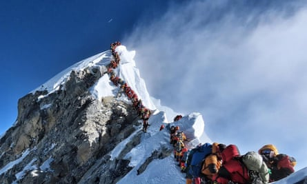 Queue of climbers trying to get to the top of Everest