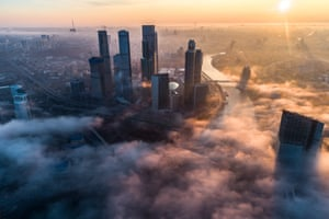 Towers of the Moscow International Business Centre shrouded in mist.