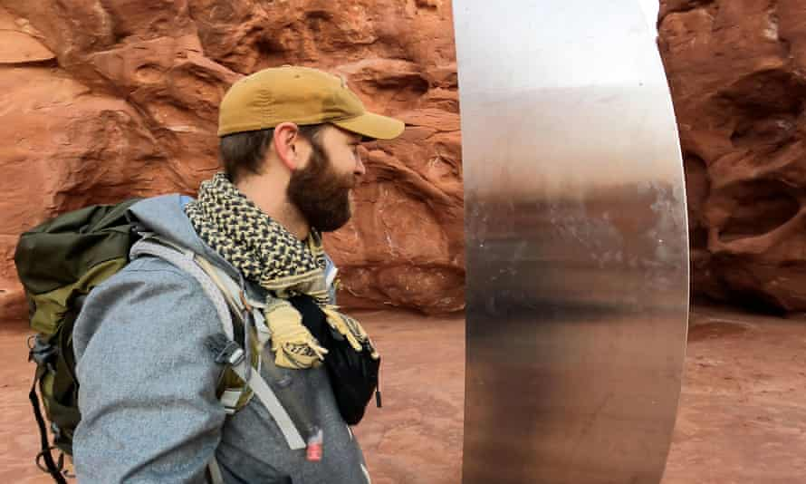 David Surber is seen after discovering the location of a metal monolith in Red Rock Desert, Utah, in this still image obtained from a social media video.