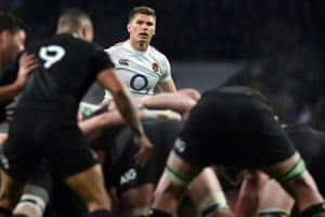England's fly-half Owen Farrell waits for the ball to leave the scrum.