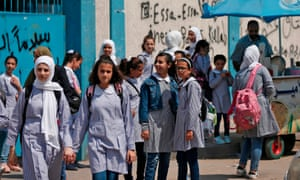 Pupils gather in front of a school run by the United Nations agency for Palestinian refugees in Gaza City.