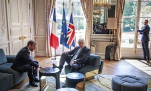 Emmanuel Macron talks to Boris Johnson during their meeting in Paris in August.