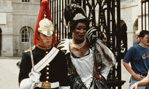A drag queen with a member of the Household Cavalry at Buckingham Palace in 1995.