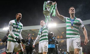 Celtic's Ryan Christie and Kristoffer Ajer parade the Scottish League Cup after the 1-0 win over Rangers.