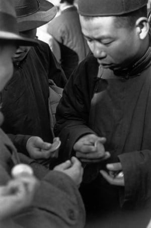 Scene from the black market for silver coins, Beijing, December 1948