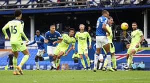 Everton's Richarlison watches his shot go wide.