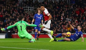 Arsenal's Pierre-Emerick Aubameyang misses a chance to score as Chelsea's Kepa Arrizabalaga attempts to save.