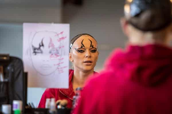 Bimini, one of RuPaul's Drag Race Drag Queens, looks in a mirror, getting made up for a shoot, March 2021