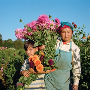 Koa Lee Cha and her grandson, Kong Lor, pick flowers on the Cha family farm in Fall City, US