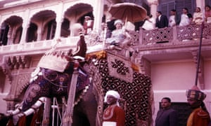 Queen Elizabeth II riding an elephant during her visit to India in 1961.