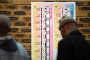 People wait to cast their votes at a polling station in Cape Town