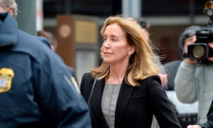 Felicity Huffman heads to court in Boston.