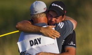 Jason Day hugs his caddie Colin Swatton