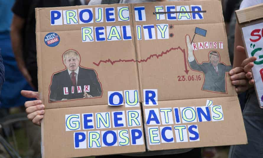 A protester holds up an anti-Brexit poster the day after the referendum.