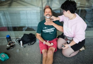 Rosalie Banner, 22, applies makeup to her father, Shawn, 59.