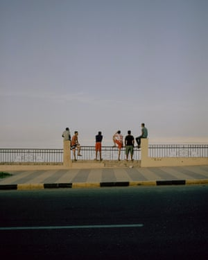 Sarah Pannell: Teens in Hurghada, March 2018 Teenage boys hang out by a public beach esplanade in Hurghada on Egypt's eastern Red Sea coast.