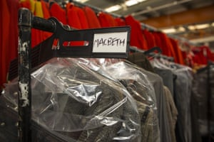 Clothing worn for the play Macbeth is hung in the stockroom