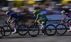 Britain's Mark Cavendish, wearing the best sprinter's green jersey, is lead out over the cobbles.