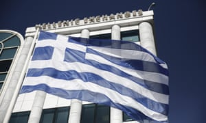 A Greek flag flies outside the Athens Stock Exchange. The exodus of its highly educated professionals has been described as 'squandering the intellectual and social capital' of Greece.