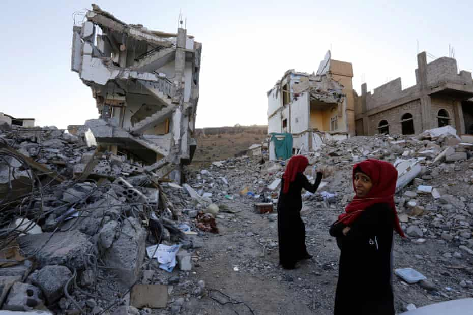 Yemeni women walk through the debris of a housing block allegedly destroyed by previous Saudi-led airstrikes, in Sana'a, Yemen, 29 September 2017
