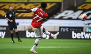 Bukayo Saka of Arsenal fires home the first goal of the game.