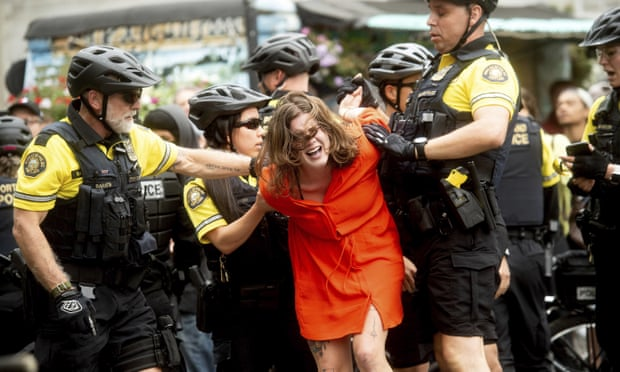 Police officers detain a protester against rightwing demonstrators in Portland, Oregon on Saturday.