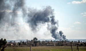 Smoke rises in the air after shelling hits Baghuz