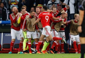 Wales' squad celebrates with Robson-Kanu.