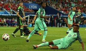 Nani slides in to direct Ronaldo's shot into the net.
