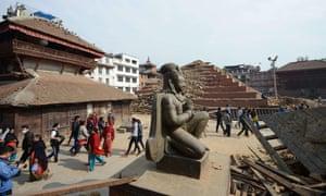 People walk by the earthquake damaged Durbar Square in Kathmandu