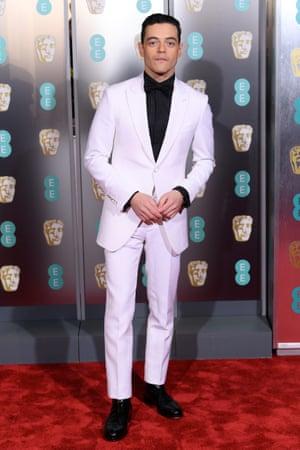 Rami Malek does monochrome, wearing a single breasted Louis Vuitton tuxedo