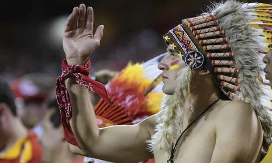 A Kansas City Chiefs fan performs the 'tomahawk chop' during a game in 2017