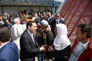 Greece's prime minister, Alexis Tsipras, greets the group of Syrian refugees flying back to the Vatican with the pope