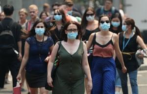 People wear face masks in response to smoke haze in Sydney.