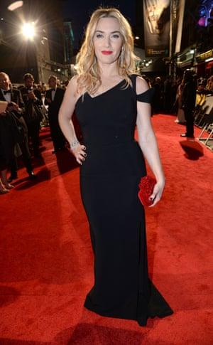 Kate Winslet in an asymmetric black cut-out dress.
