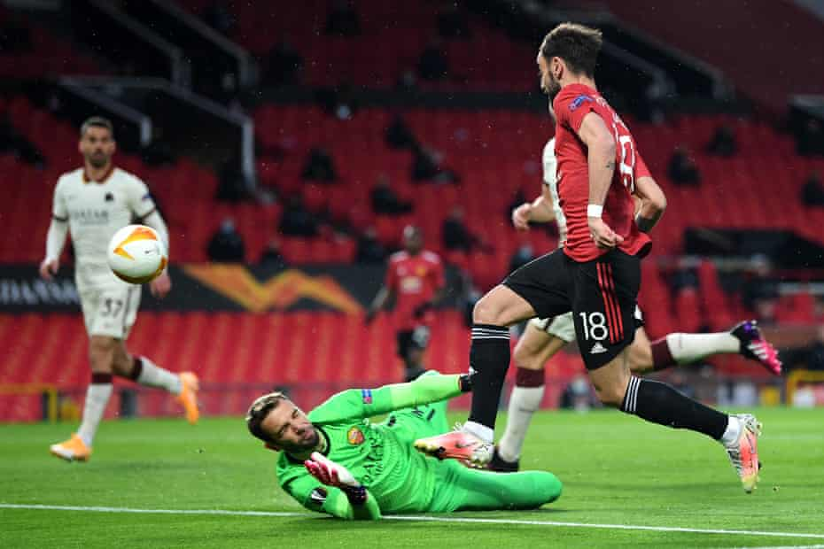 Bruno Fernandes lifts the ball over Paul López to open the scoring for Manchester United.