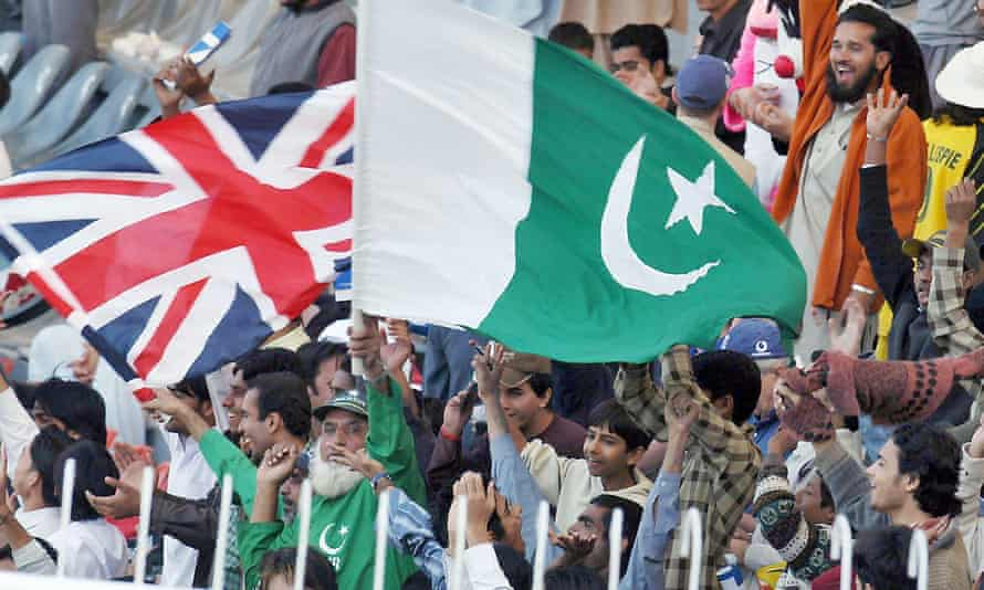 Fans in Lahore wave both nation's flags during the third Test between Pakistan and England in 2005.