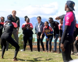 Prince Harry and Meghan, the Duchess of Sussex, join surf instructors and mentors in group activities during a visit to the NGO Waves for Change at Monwabisi Beach. The organisation supports local surf mentors to provide mental health services to vulnerable young people living in under-resourced communities