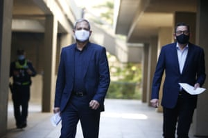 The chief health officer, Brett Sutton, and the premier, Daniel Andrews, wearing face masks outside the press conference today